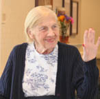 Silverado at home care senior woman waving.