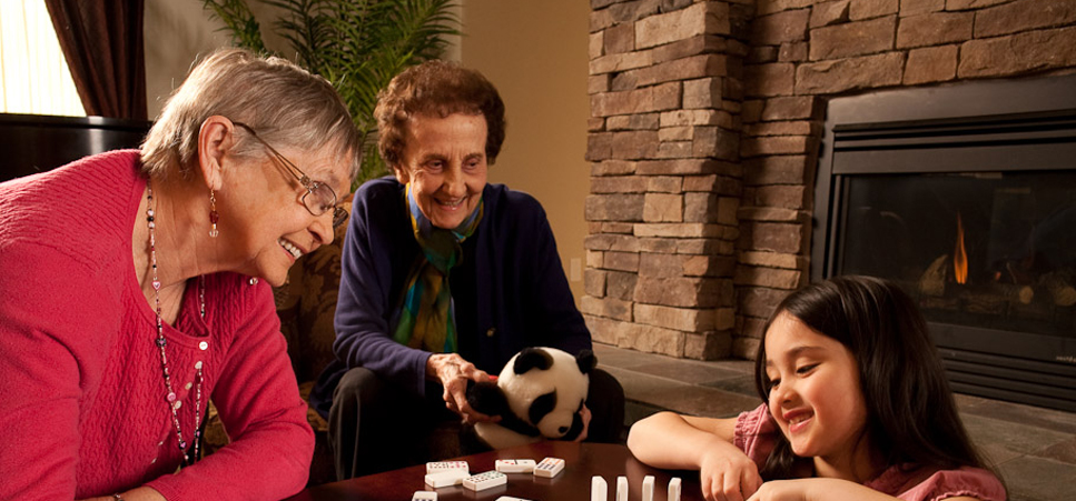 Sharon Care Center feature seniors playing game with child