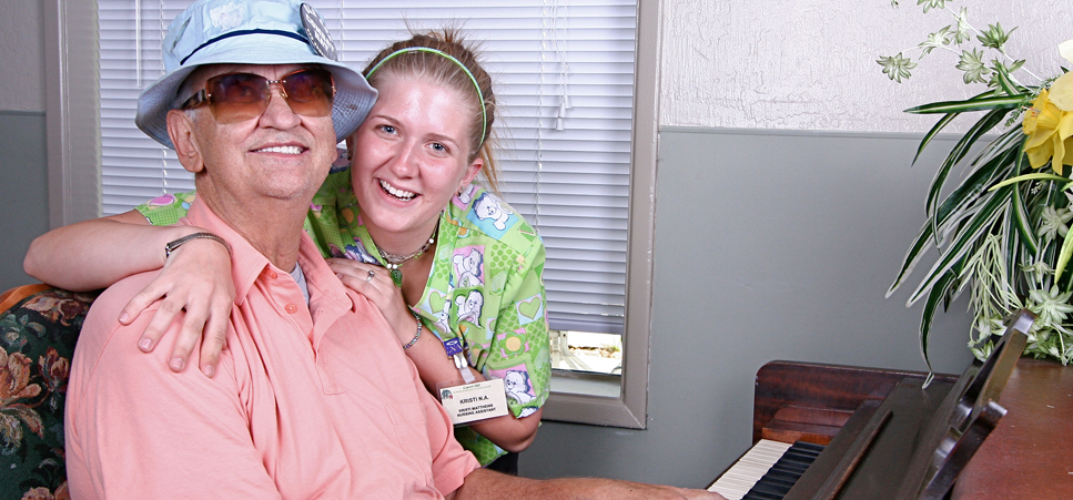 Senior playing piano at our retirement community in Grants Pass, OR 97526