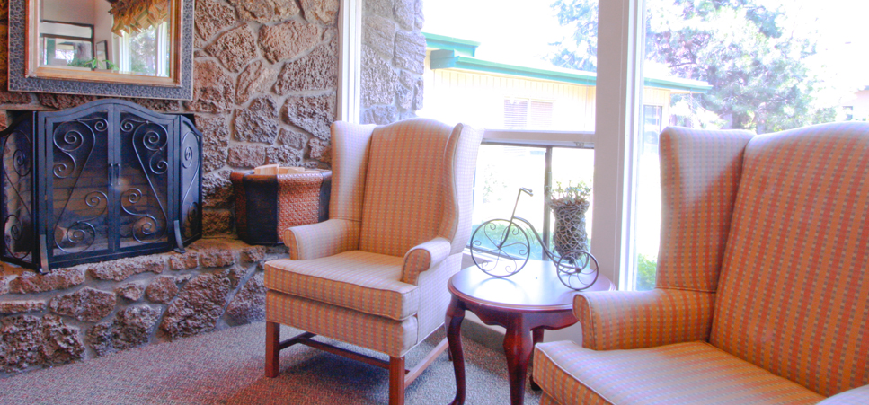 Retirement living in Bend, OR with a cozy fireplace room