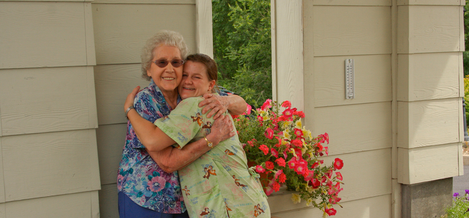 Happy senior and caretaker at our retirement community in Prineville, OR 97754
