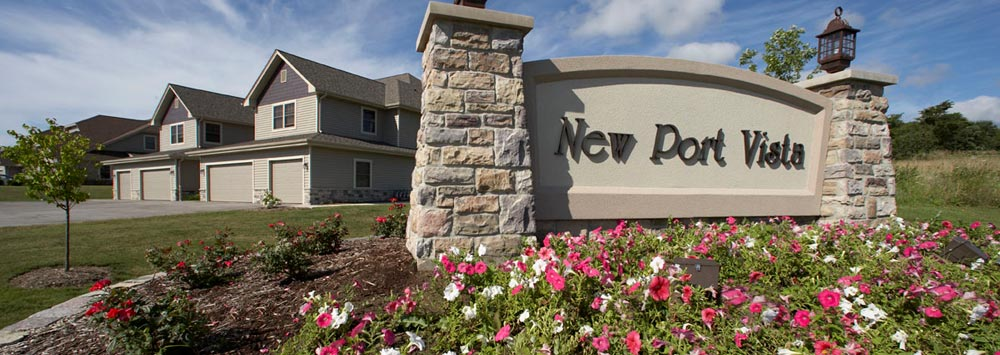 Entry sign swathed in blooms at our condominiums for sale in Port Washington, WI