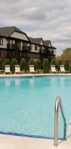 Relax by the pool at our Green Bay apartment rentals