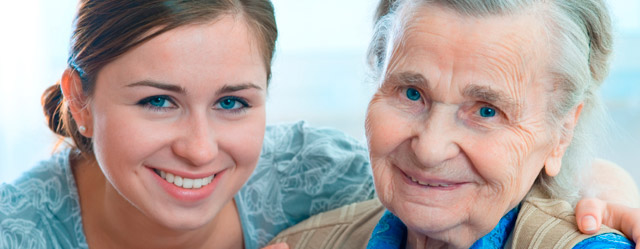 Caregiver with resident at assisted living in Calumet, MI