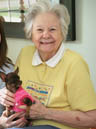 Senior woman with pet dog at Silverado Assisted Living Community.
