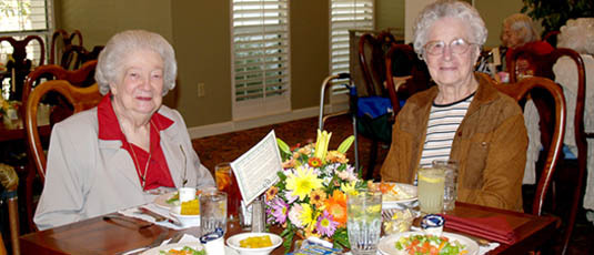 Senior friends dining Barrington Terrace of Ft. Myers - Assisted Living