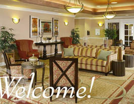 Comfortable sitting room Arbor Terrace at Crabapple Assisted Living