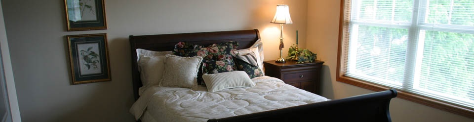 Bedroom at senior living community operated by Fiduciary Real Estate Development