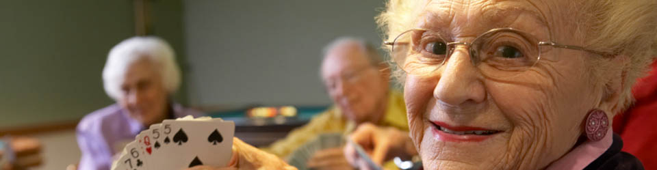 Woman playing cards at retirement community in Wisconsin