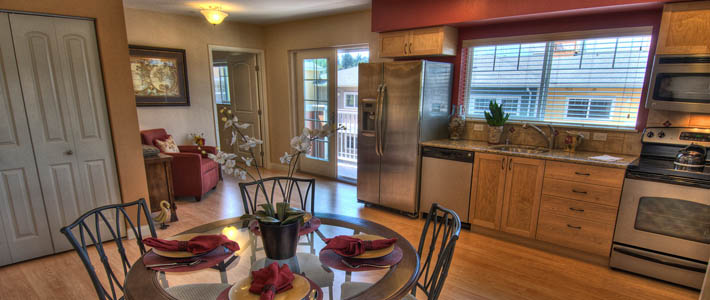 Kitchen dining area at Chateau at Bothell Landing senior living community in Washington