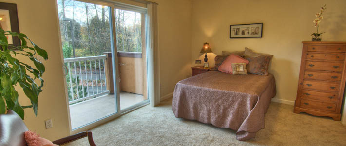 Master bedroom of one of the apartments at Chateau at Valley Center Senior Living