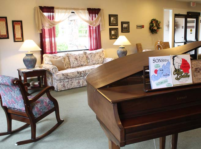 Home like lobby with piano at our Boise senior living