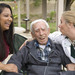 Senior man joking with his hospice nurses.