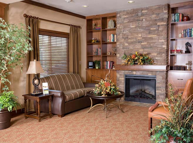 Retirement living in Newberg, OR with a fireplace sitting area
