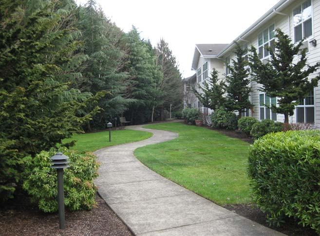 Our Eugene senior care community features tree lined paths