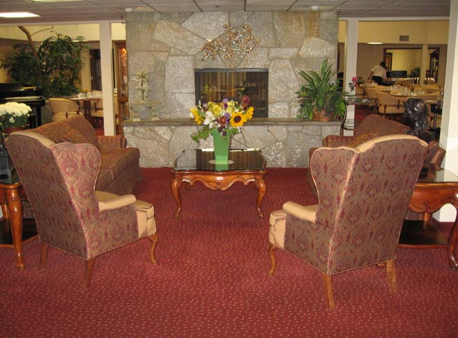 Retirement living in Medford, OR with a fireplace sitting area
