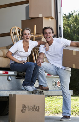 Couple unloading moving truck at BullsEye Storage