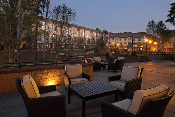 Outdoor patio at dusk at apartments in North Chapel Hill