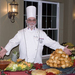 Chef showing off meal at Armour Oaks Senior Living Community