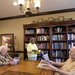 Seniors catching up on news at senior living community in Kansas City, MO