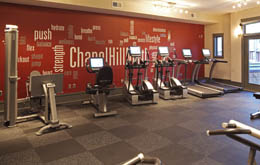 Work out in the fitness center at apartments in Chapel Hill