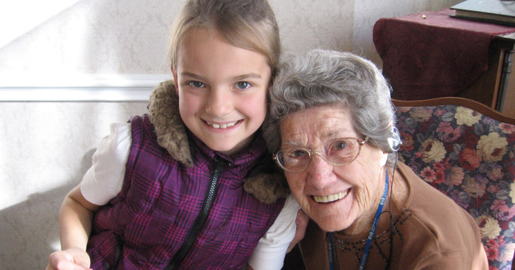 Senior and grandchild at Greeley senior living community