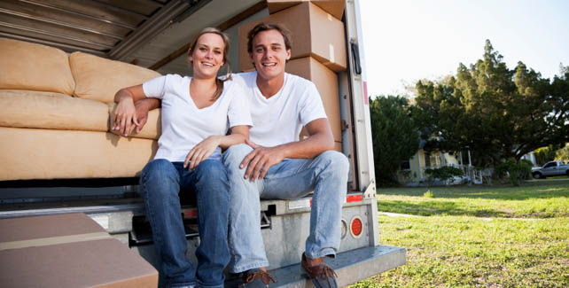 Couple sits on the edge of a moving truck headed for self storage in Ohio and Michigan