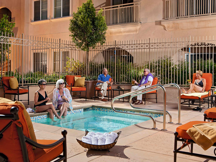 Seniors enjoying pool amenities at Peninsula Del Rey senior living community
