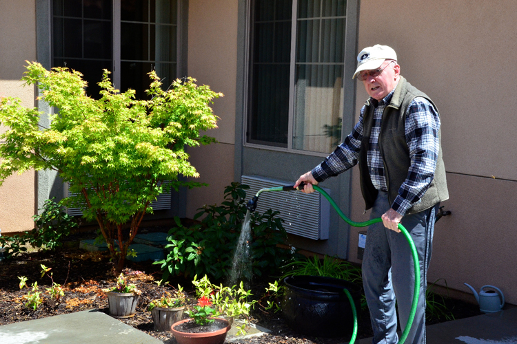 Senior enjoying gardening at Alta Manor senior living community