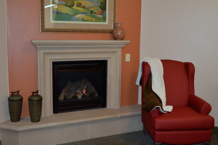 Warming fireplace at Alta Manor senior living community