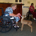 Smiling woman with fawn at Silverado memory care community in Kingwood Texas