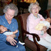 Resident feeds baby at Silverado memory care in Kingwood Texas