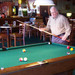 Resident playing pool at Silverado memory care center in Kingwood TX