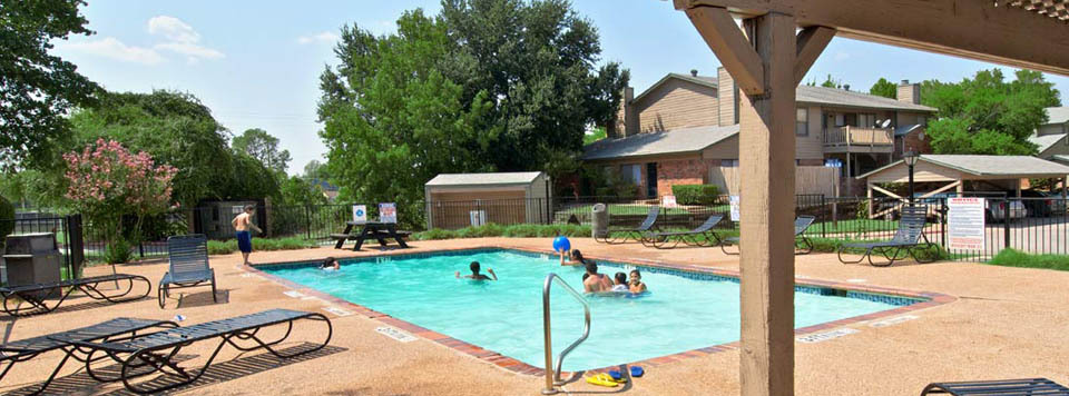 Take a dip in the sparkling swimming pool at apartments in Arlington