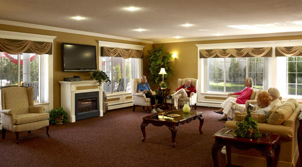Residents socialize in the lobby at Rochester Hills senior living