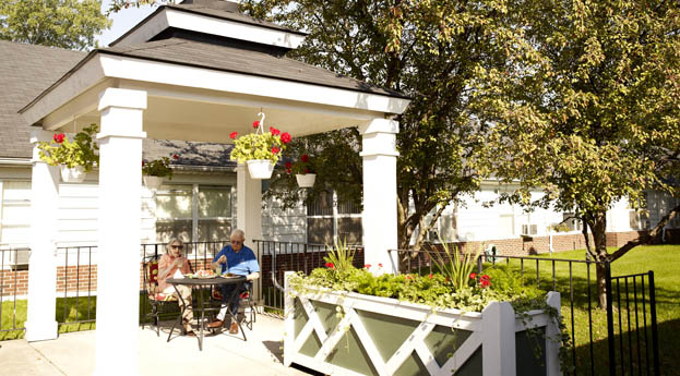 Seniors relaxing in the gazebo at senior living Rochester Hills