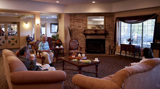 Socialize with friends in the lobby at senior living in Farmington Hills