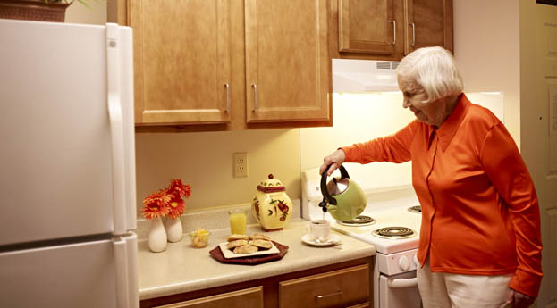 Enjoy tea and cookies in your apartment at senior living in Pontiac