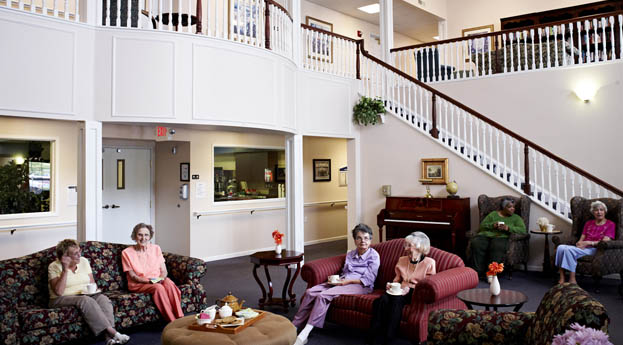 The lobby at senior living in Troy, MI is alive with activity