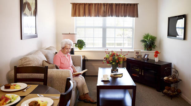A senior relaxes in her apartment in West Bloomfield