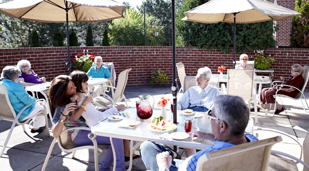Visit family on the patio at senior living in West Bloomfield