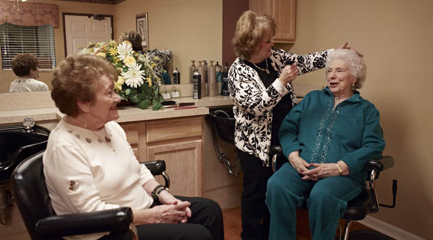 Residents get hair cuts in the salon at Clinton Township senior living