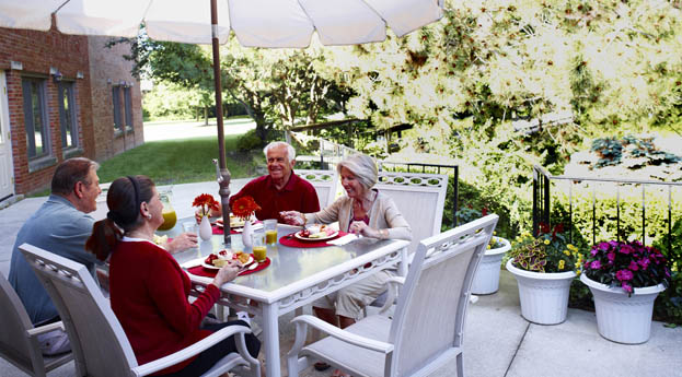Seniors dine on the patio at the retirement community in Roseville