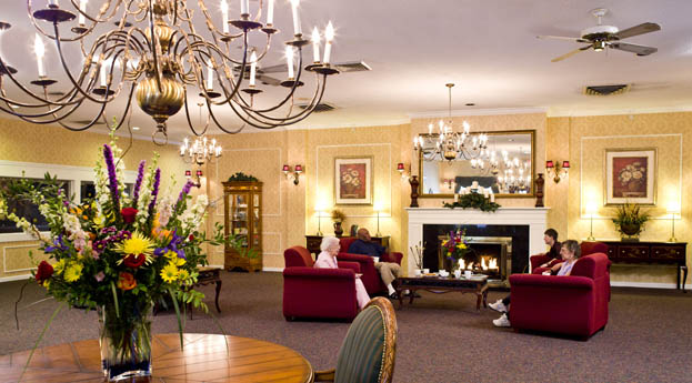 Socialize in the bright and active lobby at senior living in Livonia