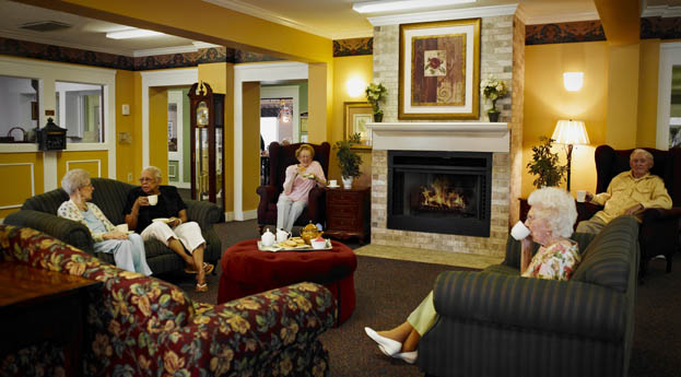 Senior living in Dearborn Heights has a lobby with fireplace, perfect for socializing in front of