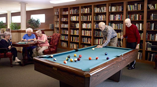 Senior living in Taylor has a library and billiards room for residents to enjoy.