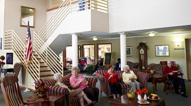 Socialize with friends in the senior living in Taylor lobby