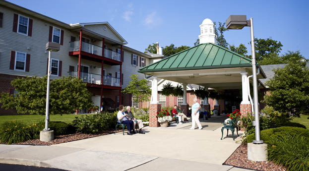 The sunny exterior of senior living in Riverview, MI welcomes you home