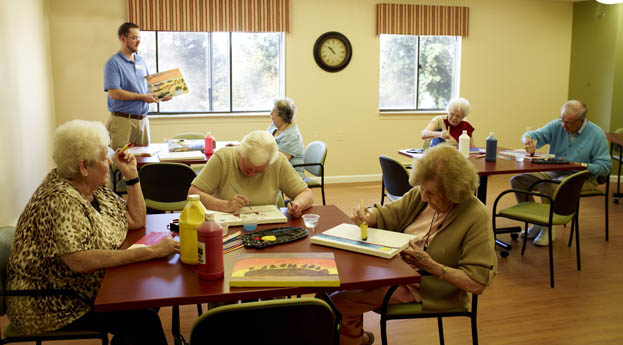 Engage in different crafts in the activity room at senior living in Grand Blanc
