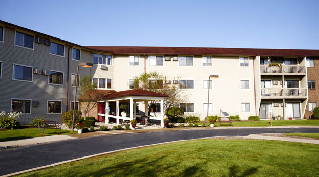 The exterior of senior living in Grand Blanc is bright and friendly
